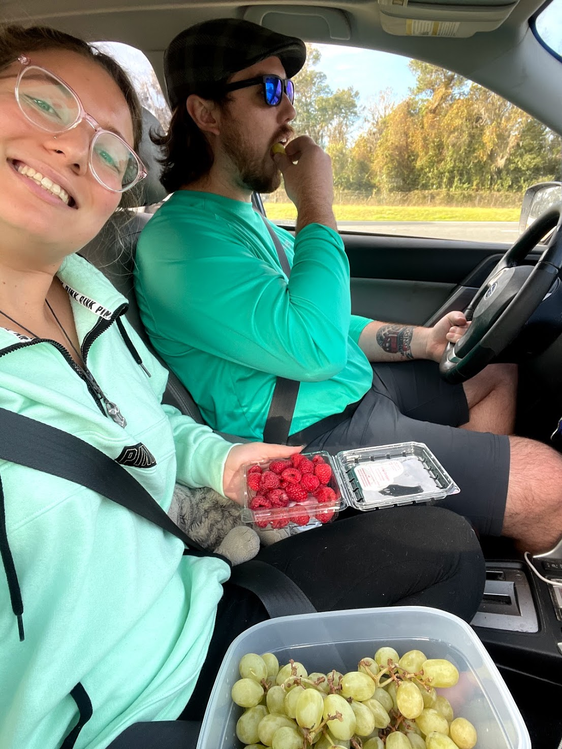 Eating our car snacks for the road trip to save money on travel